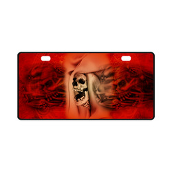 Creepy skulls on red background License Plate